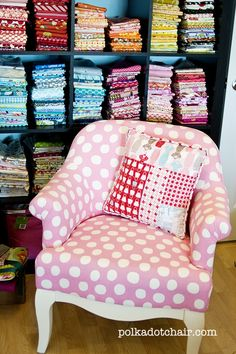 Lori Holt's fabric on a pillow and a pink polka dot chair...I've died and gone to heaven!
