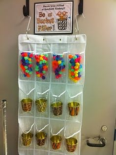 Label with stickers for individual students and fill. Bucket Filler Idea - Have large clear jar and use pom-poms to fill each time someone does something nice for someone else. Possible class reward activity when full Jungle Theme Classroom, Classroom Setting, Kindergarten Classroom, Future Classroom, Classroom Themes, Classroom Organization, Classroom Decor, Preschool Behavior, Preschool Curriculum
