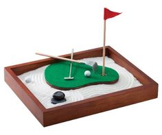 Buy the Executive Sandbox - Golf Sand Trap here, a golf themed tabletop Zen garden. Includes sand, a putting green, and other golf themed accessories. Golf Club Grips, Cool Desktop, Golf Theme, Desk Toys, Golf Accessories, Good Company, Golf Ball, Wooden Boxes, Golf Clubs