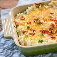 Twice Baked Cauliflower 1 large head cauliflower 4 oz. cream cheese 1/2 cup sour cream 1/4 cup minced green onions 1/4 cup freshly grated Parmesan cheese 6 slices bacon, cooked until very crisp 1 cup sharp cheddar cheese