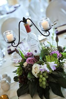 wine bottle candelabra centerpieces with fresh grape accents by Event Decorator (Bottle Centerpieces Baptism) Wine Bottle Centerpieces, Wedding Centerpieces, Wedding Decorations, Table Decorations, Wedding Ideas, Candelabra Centerpiece, Wedding Planning, Unique Centerpieces, Centerpiece Ideas