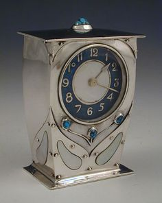 Liberty & Co. ~  Archibald Knox ~ Silver Arts & Crafts clock. Roadshow Learn about your collectibles, antiques, valuables, and vintage items from licensed appraisers, auctioneers, and experts at BlueVault. Visit:  http://www.BlueVaultSecure.com/roadshow-events.php
