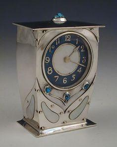 Liberty & Co. ~  Archibald Knox ~ Silver Arts & Crafts clock.