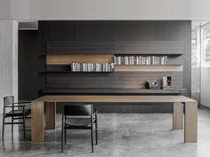 Porro Spa | Metallico table _ Neve chairs by Piero Lissoni. Load It wall shelving by Wolfgang Tolk. All on display at Graye LA