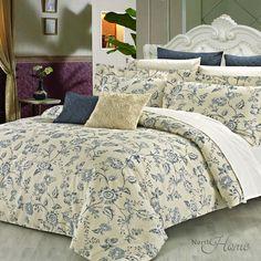 Les tons doux de crème et le bleu est la touche vintage parfait pour une chambre élégante.