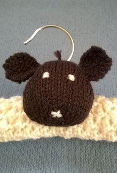 Hand knitted sheep clothes hanger by thistledown&HOPE https://folksy.com/items/6669467-Childrens-Clothes-Hanger