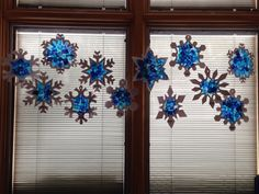 Winter stained glass snowflakes using tissue paper and clear contact paper. I cut snowflakes ahead of time. Each student had 2 snowflakes with tissue paper in the middle.