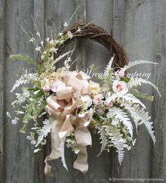 Wedding Wreath, Bridal Shower Decor, Anniversary Wreath, Elegant Floral Wreath, Garden Decor, Summer Wreath, Wedding Prop, Romantic Wreath  Classique Summer Garden Wreath. A simply stunning gathering of Hydrangeas, Roses, Peonies, Queen Annes Lace and other garden favorites in soft pastel shades of blush pink, champagne, and winter white, are set upon lush flocked ferns, gracing the edge of a rustic grapevine frame. A posh silk-like bow adds the finishing touch to lovely and gracious…