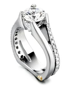 The Gleam engagement ring contains 35 diamonds, totaling 0.405ctw. Center stone sold separately, not included in price.The Gleam wedding band contains 14 diamonds, totaling 0.185ctw.