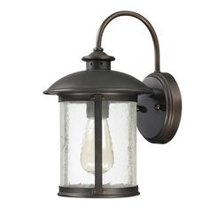 Features: -Dylan collection. -Number of lights: 1. -Finish: Old bronze. Product Type: -Wall lantern. Finish: -Old Bronze. Shade Material: -Glass. Bulb Type: -Incandescent. Wattage: -100 Watts.