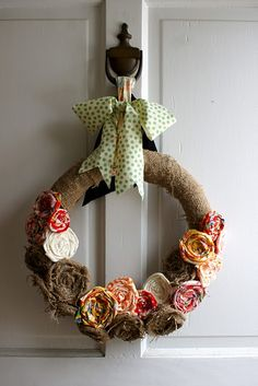 burlap wreath. love that its hanging from the knocker. @Josh Cheney you could hang a wreath from the knocker!!