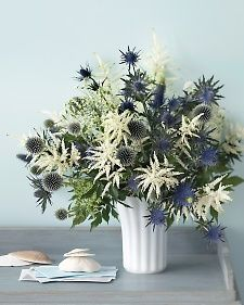 Flowers for the Fourth of July:  Silver Echinops (also known as globe thistle) and spiky, steel-blue eryngium (or sea holly) mingle with feathery white flowering astilbe and sparkler-like Queen Anne's lace. - Martha Stewart Home & Garden