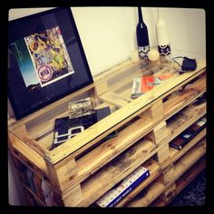 Wooden pallets, bleached, with a glass top. So cool!