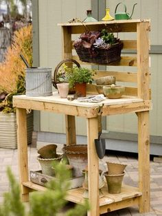 Potting bench made from a couple of wood skids. What a great idea!