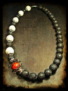 handmade necklace made of black lava beads, white round chaolitis beads and end cups