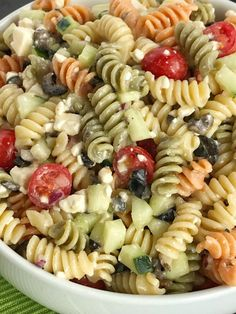 Easy Italian pasta salad will be the star of all your summer picnics and BBQ's! Takes just minutes to make and can be eaten right away or refrigerated. Tender rotini pasta, cucumber, tomatoes, red onion, black olives, and feta cheese covered in Italian dressing. So quick, easy, and delicious! Pasta salads and no bake desserts are always so popular this time of year. Which is a really good thing because they happen to be two of my favorite things! I love any and all pasta salads. There is so…