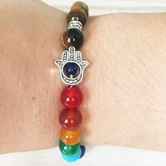 Take control of your life and restore harmony with this Tiger Eye Hamsa Bracelet. Expand your jewelry collection with our unique healing crystal jewelry. Tiger Eye Jewelry, Tiger Eye Bracelet, Tiger Eye Beads, Hamsa Jewelry, Jewellery, Fine Jewelry, Jewelry Making, Tigers Eye Gemstone, Healing Crystal Jewelry