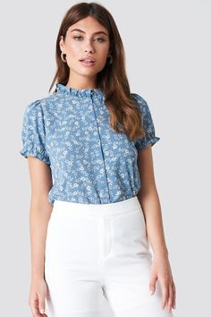63f8fb4a07a7 The Ruffle Detail Button Blouse by NA-KD Boho features ruffle details at  cuffs and