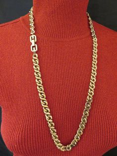 Don't be linked to boring when you can wear a Givenchy necklace composed of golden chunky curb links.