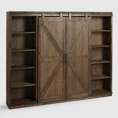 A substantial storage solution with adjustable and removable shelving, our bookshelf is crafted of distressed solid wood with rustic metal accents that give it the look of an old barn door. Configure the sliding doors to organize and display books, photos Bookcase, Doors Interior, Barn Door Entertainment Center, Barn Door Bookcase, Rustic Metal, Old Barn Doors, Alder Wood, Sliding Doors, Murphy Bed Plans