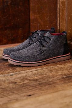 TOMS Charcoal Fleck Men's Chukka Boots with a bright red plaid lining. These durable boots were designed with little details in mind.