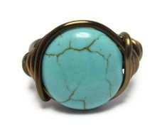Wire Wrapped Ring Made with a 12mm Turquoise magnesite gemstone coin bead. Wrapped with 18 gauge non tarnish antique brass plated wire. Made to