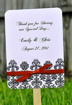 Damask wedding favors/fans...another way to do ceremony favor fans...I really like this idea since outside might be nice if they had fan...design simple and pretty