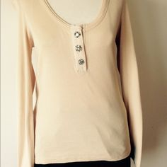 Chloe cream longsleeve top with rhinestone buttons Chloe cream longsleeve top with three different rhinestone buttons!  They are actually snaps. Low cut scoop neck. Looks super cute on! Chloe Tops