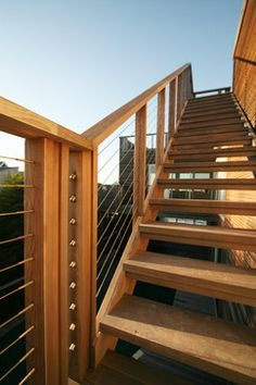 Cedar and ipe open tread stair at Fire Island House with cable rail leads to a roof deck with ocean views. By Resolution: 4 Architecture. Exterior Stair Railing, Outdoor Handrail, Outdoor Stairs, Hand Railing, Modern Deck, Modern Stairs, Fire Island, Pergola Ideas For Patio, Outdoor Landscaping