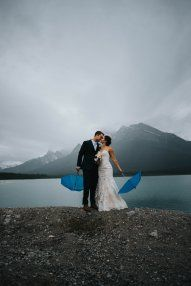 Ashton and Jeff's Canmore wedding photographed by Riana Lisbeth Photography exquisitely captured the love and affection these two have for each other. You can tell this wedding party truly enjoyed their time together despite the rainy weather. The day started beautifully and quite calmly, with clouds slowly rolling in. When it came time for the ceremony it was raining off and on, but luckily the limo driver was running 20 minutes behind making the ceremony run late. As the girls finally…