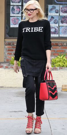 Gwen Stefani mixes black and red by pairing overalls with a graphic sweater and standout accessories // #Style