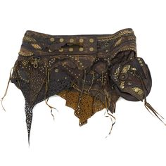 Brown leather tribal skirt with differents pieces of leather and textured. Brass rivets and eyelets, pocket on belt. Tribal goddess warrior leather mini skirt, post apocaliptic rivets and leather skirt, Mad Max, Burning man trance party clothes, steampunk style. Others models on baliwoodshop.com