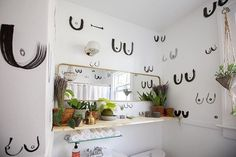 Did you guys click through the @apartmenttherapy tour I did with @haegur until you spied this bbie bathroom?! Love that guys fierce and fearless design choices and obviously all of the plants. This bathroom got a serious number of comments over on the Apartment Therapy page so I was curious what you all would think! Clearly Im all about it.  Amazing hand painted walls by local artist @carriebethwaghorn