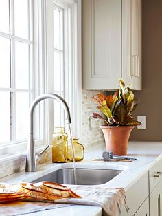 Cleanup Zone is just down the countertop from the cooking zone with dishwasher and cabinets to put dishes away nearby.