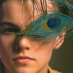 Ummmm... Leonardo DiCaprio, what are you doing? With a peacock feather?