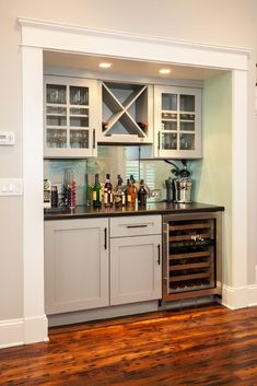 Design-Build Built in storage, fridge, china display up top. House of Turquoise: Renewal Design-BuildBuilt in storage, fridge, china display up top. House of Turquoise: Renewal Design-Build Wet Bar Basement, Basement Kitchenette, Basement Ideas, Basement Closet, Modern Basement, Basement Finishing, Basement Flooring, Flooring Ideas, Wood Flooring