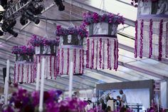 Shades with famous jewish people's photographs with crystal beads and orchid leis and a wreath of florals hanging from the tent top at the National Museum of American Jewish History Opening Gala 2010 {Design: TableArt}