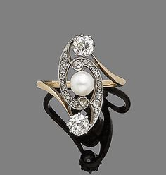 """Pinner: """"An art nouveau cultured pearl and diamond-set dress ring, circa 1910  Centrally set with a cultured pearl within a rose-cut diamond swirl, terminating in old-brilliant-cut diamonds, diamonds approx. 0.85ct total."""""""