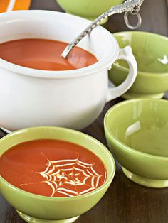 Before hungry little spooks go out to ring trick-or-treat doorbells, serve them a bowl of slurp-a-liscious spider web soup! www.bhg.com/halloween/recipes/spiderweb-soup-topping/ (Halloween, food)