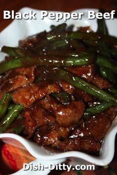 Black Pepper Beef with Green Beans Recipe by Dish Ditty Recipes - This Chinese Stir Fry dish is popular for a reason. it is simply fabulous with it's peppery sauce and crisp green beans. To veganize. Beef And Green Beans Recipe, Green Bean Recipes, Beef With Black Bean Sauce, Steak And Green Beans, Black Beans, Stir Fry Dishes, Beef Dishes, Meat Dish, Black Pepper Beef