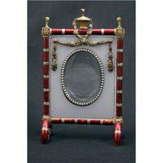 Google Image Result for http://www.jewellerynetasia.com/files/UserUploadImage/Showroom/Product/400/Faberge%2520Frame_20060702113835.JPG