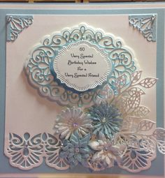This card is made using dies from Sue Wilson Scandinavian collection; Sue Wilson Finishing Touches dies; Sue Wilson Gemini Collection and Tonic Studio Verso Roselily and Delicate Daisy Die Set