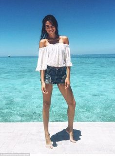 Saying goodbye in style: Shanina Shaik bid farewell to the Maldives on Monday as she donned a pair of denim short shorts for a leggy Instagram snap