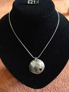 Sterling silver domed pendant with a cut out star