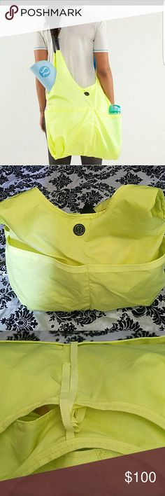Lululemon bag Lululemon bag. Yellow, extremely sturdy and washable! Contains one zippered bag inside and 4 side pockets. Closes with a lace on the sides. Very big to store many things. Has its original strap to hang as a purse or as a messenger back. Has a needle sized hole, extremely tiny and a washable stain on the side towards the bottom. Very very excellent buy. lululemon athletica Bags