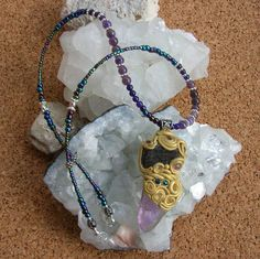 Amazon.com: Clay Wrapped Crystal Pendant made with Amethyst Citrine Blue Aventurine Gold on Amethyst Blue Aventurine Glass Beads Crystal Beaded Matinee Length Necklace: Handmade