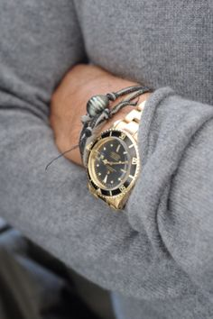 Black and gold Rolex Submariner and love the gray shirt!