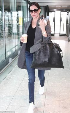 Jet-setter: Lauren Silverman, 39, worked her airport attire as she arrived at Heathrow's Terminal Five in London to catch a flight to New York on Friday