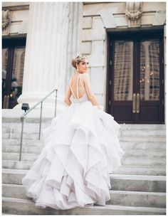 Beautiful bride in exquisite tulle dress with flounce skirt and chapel train by Hayley Paige from The White Magnolia Bridal Collection at Le Méridien Tampa in Tampa, FL. Image by Papered Heart Photography.