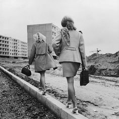 Antanas Sutkus    Lazdynu pradzia, Saligatvis, Vilnius, 1976. This is how people avoided having mud on their shoes during communism.